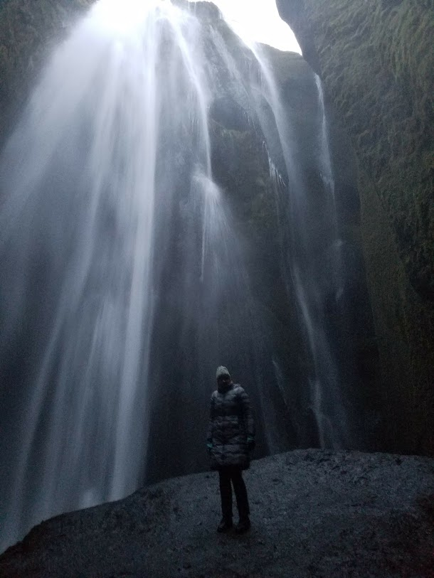 BJ Knapp author of Beside the Music visits a waterfall in Iceland.