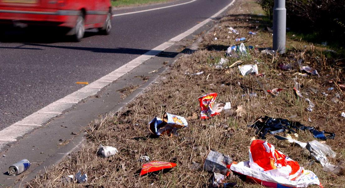 BJ Knapp author of Beside the Music picks up litter on the road.